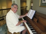 Dick Wright warms up at the piano for singing with the Choir at THE LIT